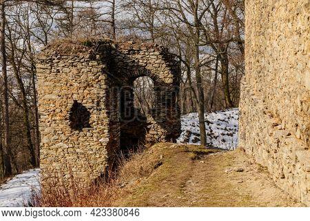 Medieval Gothic Castle Kostomlaty Or Sukoslav Under Snow, Grey Stone Ruin On Hill At Sunny Winter Da