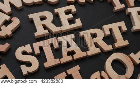 Restart, Text Words Typography Written With Wooden Letter On Black Background, Life And Business Mot