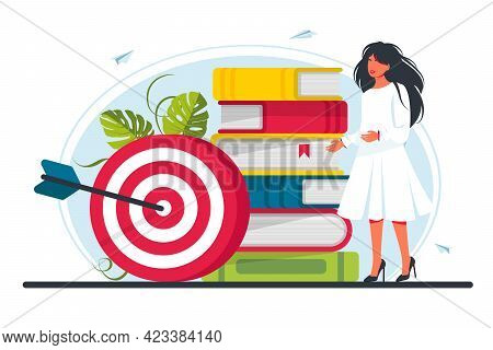 Woman Stands By A Stack Of Books At The Target. Move Up Motivation, The Path To The Target's Achieve