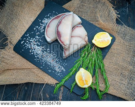 Fresh Uncooked Blue Shark Steaks With Lemons