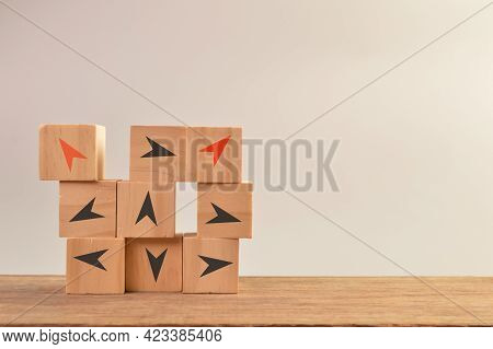 Wooden Blocks With Different Arrow Directions. Business Innovation, Unique And Think Different Conce