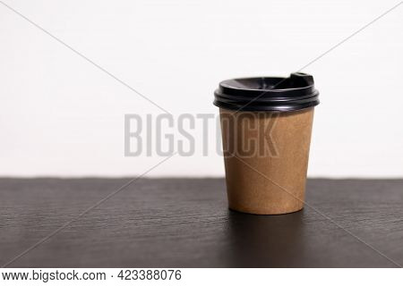 Disposable Coffee Cup For Cafe On The Table. Brown Cardboard Mockup Of Eco Friendly Coffee Cup Isola