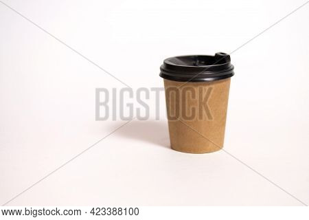 Disposable Coffee Cup For Cafe On A White Background. The Concept Of Environmentally Friendly Tablew