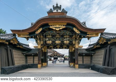 Kyoto, Japan - 05.30.2019: Look Through The Richly Decorated Gate Of Nijo Castle, Kyoto, Japan. Peop