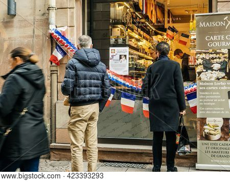 Strasbourg, France - Circa 2020: People Reading In Front Of Maison Lorho With Announcement Award Of