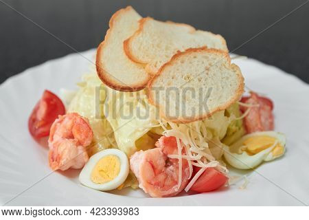 Gourmet Caesar Salad With Shrimps And Croutons.