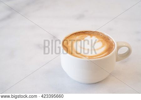 Close-up Of Hot Coffee Latte With Latte Art Milk Foam In Cup Or Mug On Desk In Coffee Shop At The Ca