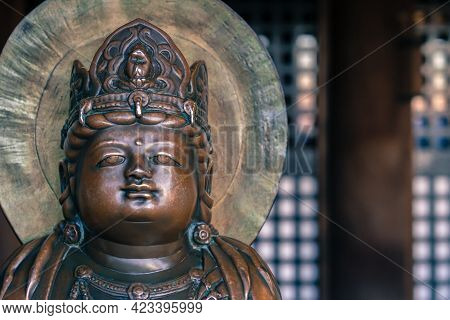Small Bronze Buddha Statue With Crown On His Head In An Old Buddhist Temple Of Kiyomizu Dera In Kyot