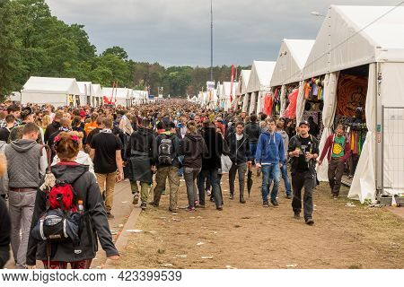 Kostrzyn Nad Odra, Poland - July 15, 2016: People Walking Between The Commercial Tents At The Przyst