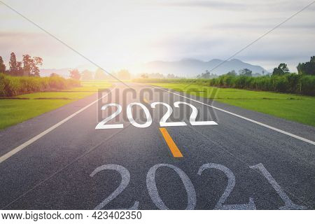 Concept New Year With The Word 2021 To 2022 Written On The Asphalt  Road In Country Road Decorate Or