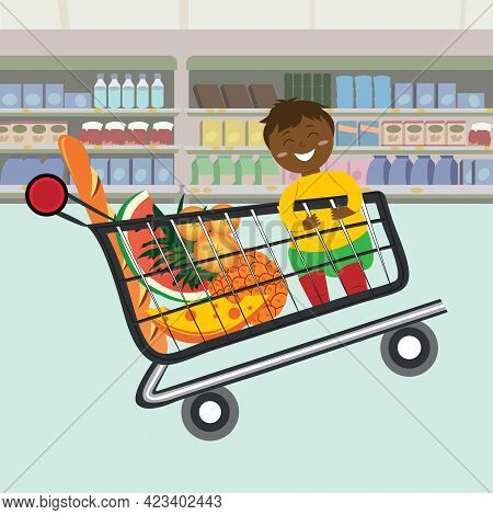 Kid Sitting In A Supermarket Shopping Cart Full Of Groceries. Shelves With Groceries In Supermarket.