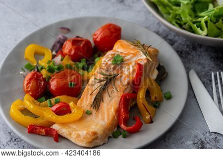 Baked Red Fish Fillet Arctic Char On A Plate With Vegetables, Mix Salad In A Bowl, Delicious Hearty