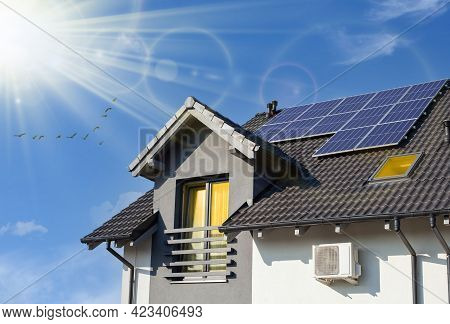 Solar Panel On The Roof Of A Moder Home. Concept Clean Power Energy.