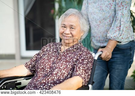Help And Care Asian Senior Or Elderly Old Lady Woman Patient Sitting On Wheelchair At Home, Healthy