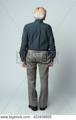 Rear view of a senior man in a tartan scott shirt