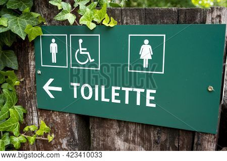 Green Direction Sign Toilette, Men ,women And Disabled.