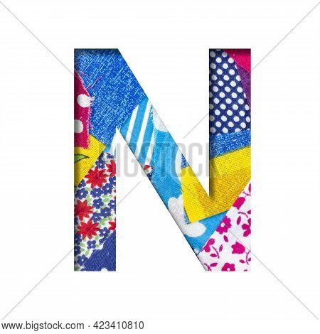 Handicraft Or Creative Font. The Letter N Cut Out Of Paper On The Background Of The Texture Of Piece