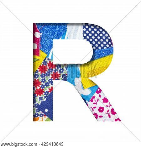Handicraft Or Creative Font. The Letter R Cut Out Of Paper On The Background Of The Texture Of Piece
