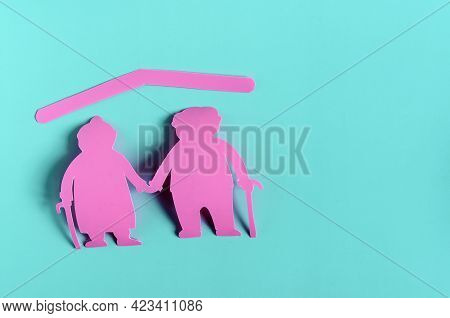 Bright Red Figures Of Two Elderly People On A Colored Background. The Concept Of Social Protection O