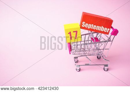 September 17th. Day 17 Of Month, Calendar Date. Close Up Toy Metal Shopping Cart With Red And Yellow
