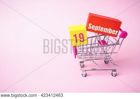 September 19th. Day 19 Of Month, Calendar Date. Close Up Toy Metal Shopping Cart With Red And Yellow