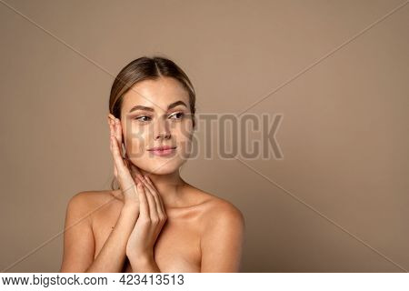 Skin Care. Woman With Beauty Face Touching Healthy Facial Skin. Beautiful Smiling Caucasian Female M