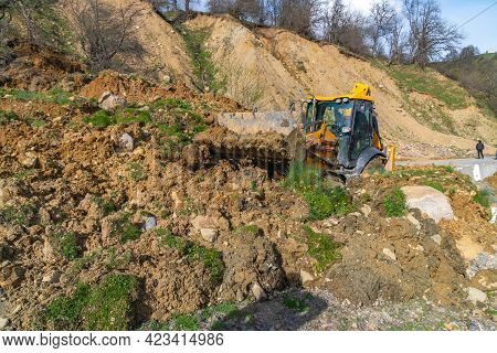 The Tractor Clears The Road From A Landslide. Svaneti