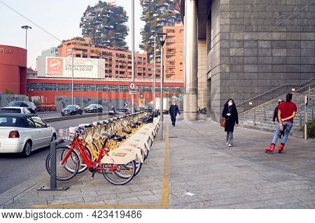 Bicycle Rental Service Stand In Row Parking On Garibaldi Area. Bicycles With Basket For Traveling Ar