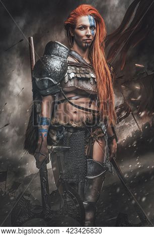 Nordic Woman Warrior With Axes In Battlefield