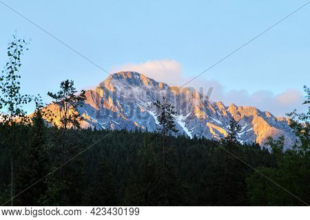 Sunset Over The Canadian Rockies At Johnston Canyon, Surrounded By Pine Trees, In Banff National Par