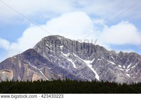 Mountain Range Of The Canadian Rockies At Johnston Canyon, Surrounded By Pine Tree Forest, In Banff