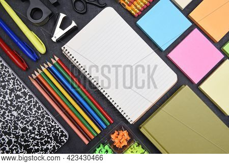 School Supplies: Top view still life on white of asorted school supplies with copy space.