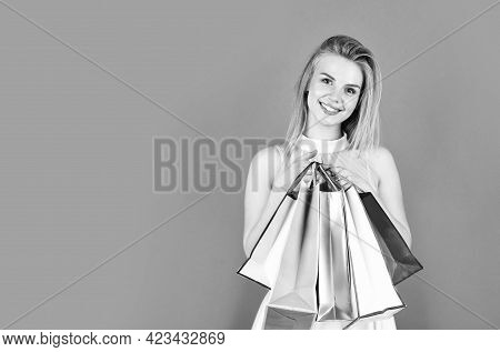 Cyber Monday Concept. Gifts And Presents For Any Holiday. Fashion Model With Paper Bag Packages. Sel