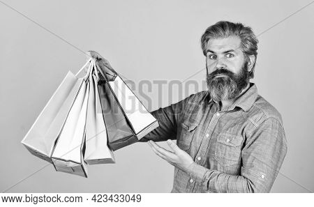Retail Concept. Happy Holidays. Handsome Buyer. Free Shipping. Bearded Man Hold Shopping Bags. Seaso