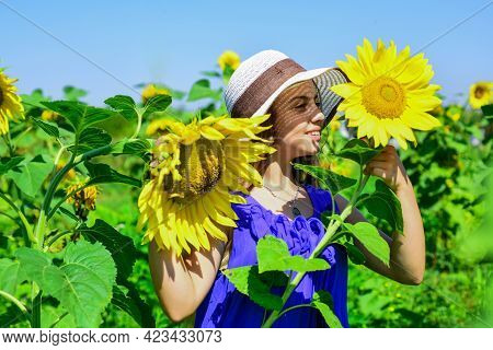 Happy Childrens Day. Childhood Happiness. Portrait Of Happy Kid With Beautiful Sunflower. Cheerful C