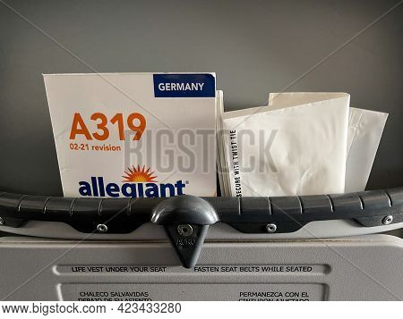 An Allegiant Airplane  Brochure Containing Safety Information About The Airplane That Is Found In Th