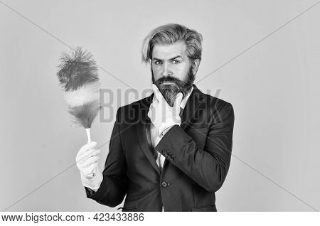 Serious Attitude. Hipster Holding Cleaning Tool. Cleaning And Home Concept. Man Sweeping With Small