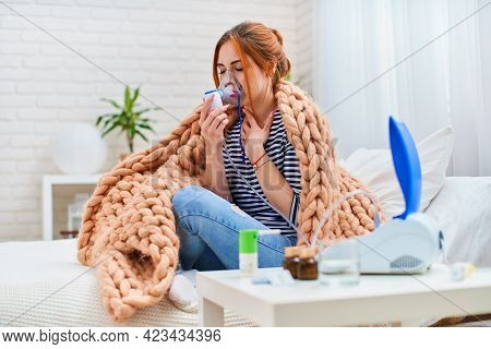 Sick Young Girl Is Tired Chest Coughing While Holding An Inhaler, Having An Asthmatic Allergy With A