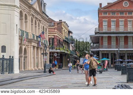 New Orleans, La - September 24: Tourists In Jackson Square Amidst Historic Buildings On September 24