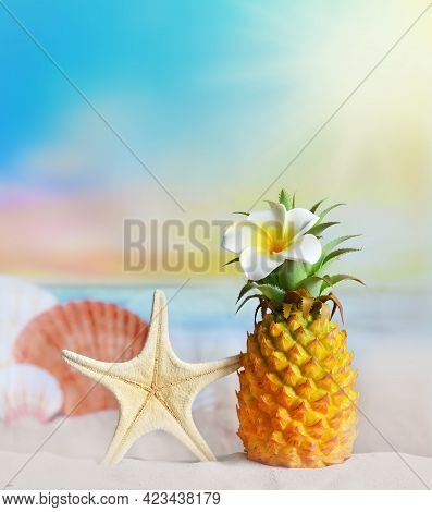 Pineapple With Flower And Seashell In The Beach. Summer Concept.
