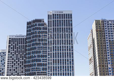 Modern High-rise Apartment Buildings. Housing For Urban Families In A Residential Area. Geometric Fa