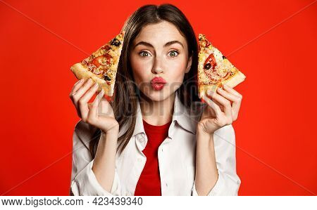 Cute Girl Shows Two Slices Of Delicious Pizza Takeaway, Making Kissing Face, Loves Pizzeria Fastfood