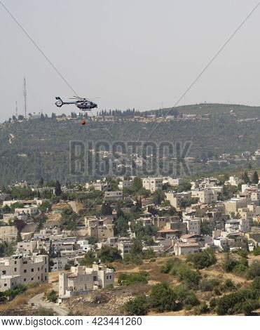 Abu Ghosh, Israel - June 10th, 2021: An Israeli Police Helicopter, Equipped With A Water Container U