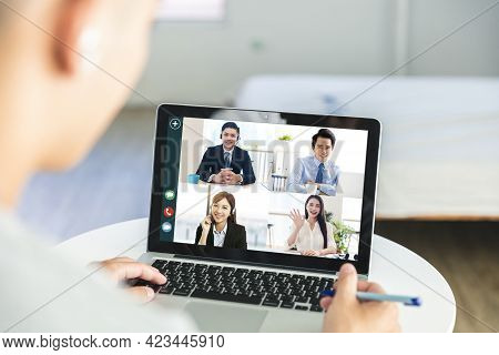 Business People Use Laptops For Web Meetings At Home, Discuss Work And Schedules With Colleagues Thr