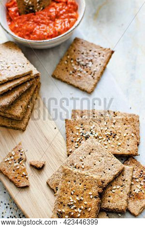 Healthy organic seeded rye crackers with salsa sauce