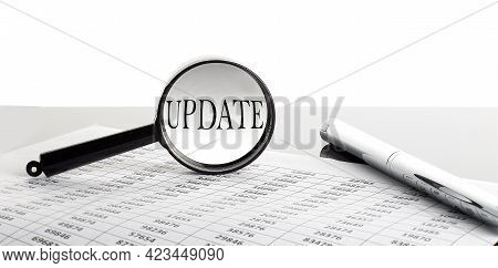 Magnifying Glass With Text Update On Background With Pen