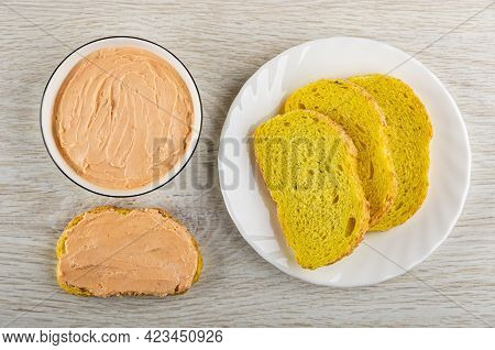 White Glass Bowl With Creamy Fish Oil, Sandwich, Slice Of Cornbread In Plate On Wooden Table. Top Vi