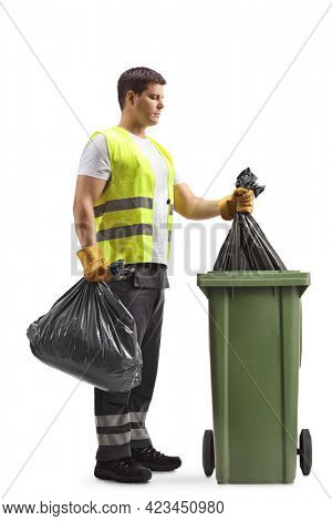 Full length profile shot of a young man waste collector taking a bag from a bin isolated on white background