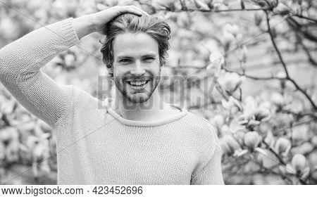 Hipster Enjoy Blossom Aroma. Springtime Concept. Unshaven Man Sniff Bloom Of Magnolia. Man Flowers B