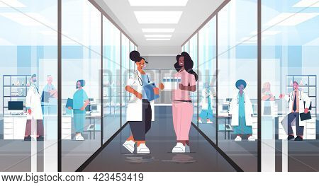 Mix Race Doctors In Uniform Discussing During Meeting In Hospital Corridor Medicine Healthcare Conce
